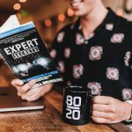Man Reading Book on Expertise
