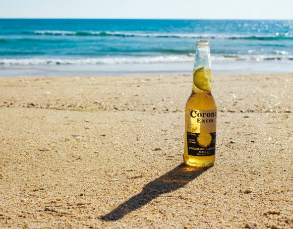 Corona Beer Bottle on Beach
