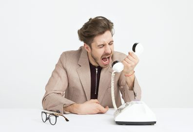 Man frustated yelling into phone